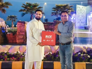 Mr. Kaleem Ullah Gilani Handing over the Goodie Bag to Participant of Tree Plantation Campaign